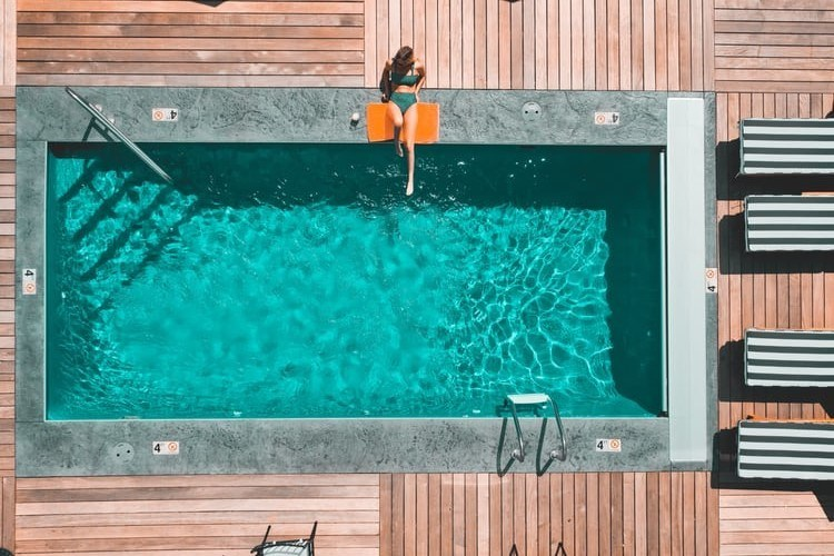 Woman sitting on the pool edge