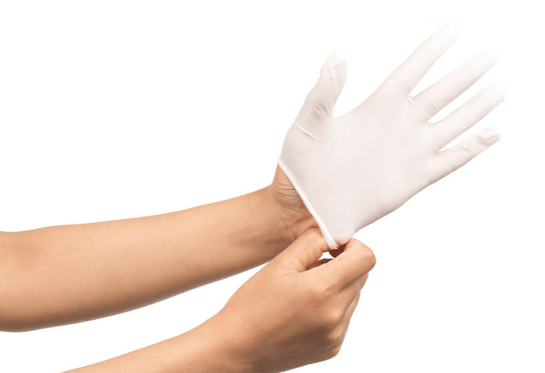 a white glove on the hand