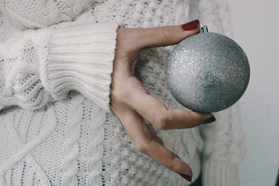 woman holding a silver ball