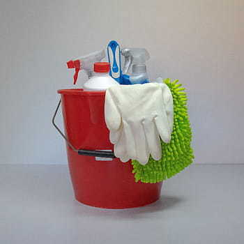 a bucket with cleaning accessories